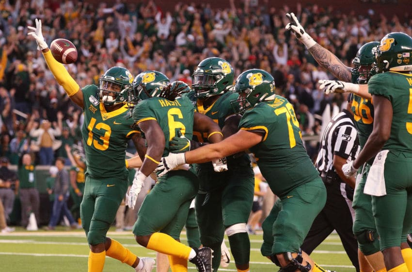 WACO, TEXAS - OCTOBER 12: The Baylor Bears celebrate the overtime win against the Texas Tech Red Raiders on a touchdown by JaMycal Hasty #6 on October 12, 2019 in Waco, Texas. (Photo by Richard Rodriguez/Getty Images)
