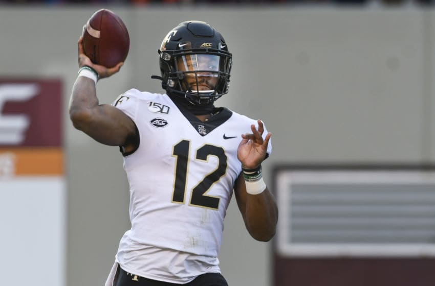 BLACKSBURG, VA - NOVEMBER 9: Quarterback Jamie Newman #12 of the Wake Forest Demon Deacons throws against the Virginia Tech Hokies in the first half at Lane Stadium on November 9, 2019 in Blacksburg, Virginia. (Photo by Michael Shroyer/Getty Images)