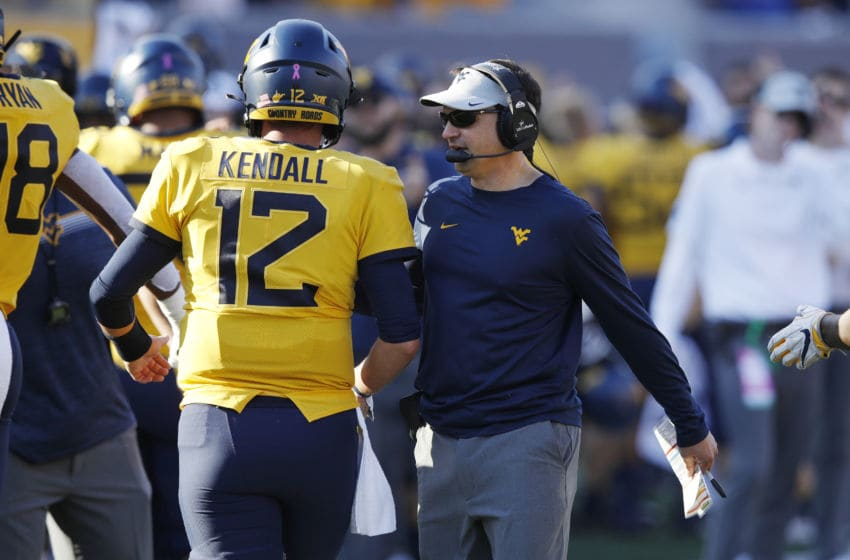 MORGANTOWN, WV - OCTOBER 05: Head coach Neal Brown of the West Virginia Mountaineers talks to Austin Kendall #12 during a game against the Texas Longhorns at Mountaineer Field on October 5, 2019 in Morgantown, West Virginia. Texas defeated West Virginia 42-31. (Photo by Joe Robbins/Getty Images)