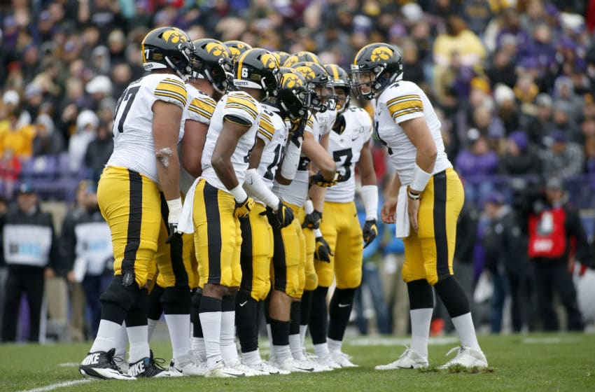 EVANSTON, ILLINOIS - OCTOBER 26: Nate Stanley #4 of the Iowa Hawkeyes huddles up with his team during the first quarter in the game against the Northwestern Wildcats at Ryan Field on October 26, 2019 in Evanston, Illinois. (Photo by Justin Casterline/Getty Images)