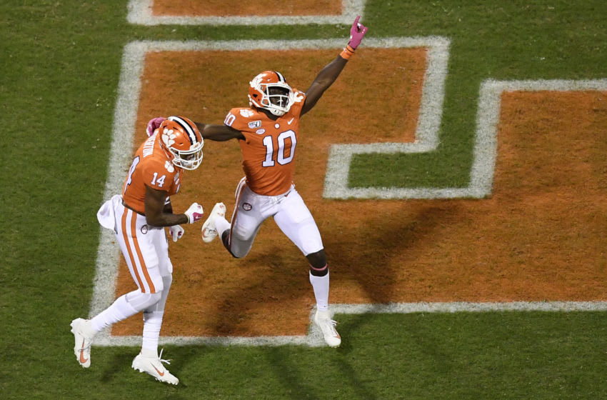 CLEMSON, SOUTH CAROLINA - OCTOBER 26: Wide receiver Joe Ngata #10 celebrates with wide receiver Diondre Overton #14 of the Clemson Tigers after Overton scores a touchdown against the Boston College Eagles during the first quarter of their football game at Memorial Stadium on October 26, 2019 in Clemson, South Carolina. (Photo by Mike Comer/Getty Images)