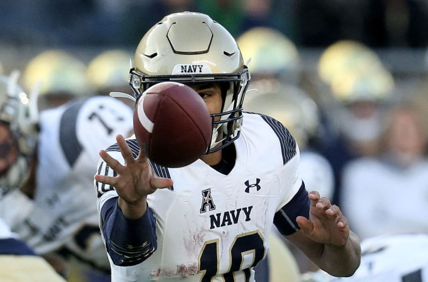SOUTH BEND, INDIANA - NOVEMBER 16: Malcolm Perry #10 of the Navy Midshipmen tosses the ball in the third quarter against the Wisconsin Badgers at Notre Dame Stadium on November 16, 2019 in South Bend, Indiana. (Photo by Dylan Buell/Getty Images)