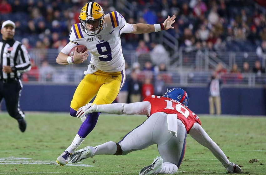 OXFORD, MISSISSIPPI - NOVEMBER 16: Joe Burrow #9 of the LSU Tigers runs with the ball as Jacquez Jones #10 of the Mississippi Rebels defends during the first half of a game at Vaught-Hemingway Stadium on November 16, 2019 in Oxford, Mississippi. (Photo by Jonathan Bachman/Getty Images)