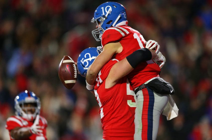 OXFORD, MISSISSIPPI - NOVEMBER 16: John Rhys Plumlee #10 celebrates a touchdown with Michael Howard #52 of the Mississippi Rebels during the second half of a game against the LSU Tigers at Vaught-Hemingway Stadium on November 16, 2019 in Oxford, Mississippi. (Photo by Jonathan Bachman/Getty Images)