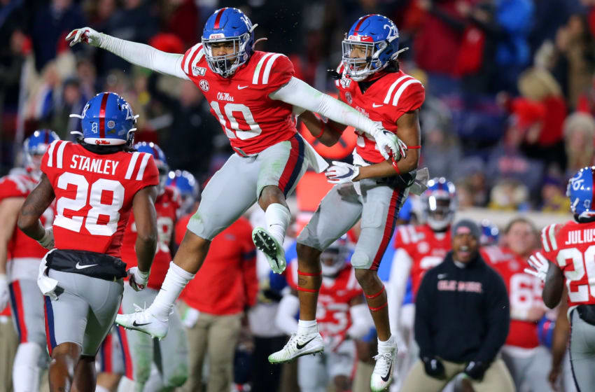 OXFORD, MISSISSIPPI - NOVEMBER 16: Deantre Prince #24 of the Mississippi Rebels celebrates an interception with Jacquez Jones #10 of the Mississippi Rebels during the second half of a game against the LSU Tigers at Vaught-Hemingway Stadium on November 16, 2019 in Oxford, Mississippi. (Photo by Jonathan Bachman/Getty Images)