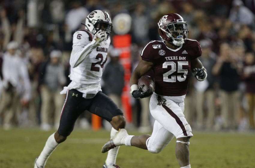 COLLEGE STATION, TEXAS - NOVEMBER 16: Cordarrian Richardson #25 of the Texas A&M Aggies breaks loose for a 75-yard run for a touchdown during the fourth quarter as Israel Mukuamu #24 of the South Carolina Gamecocks is unable to catch him at Kyle Field on November 16, 2019 in College Station, Texas. (Photo by Bob Levey/Getty Images)