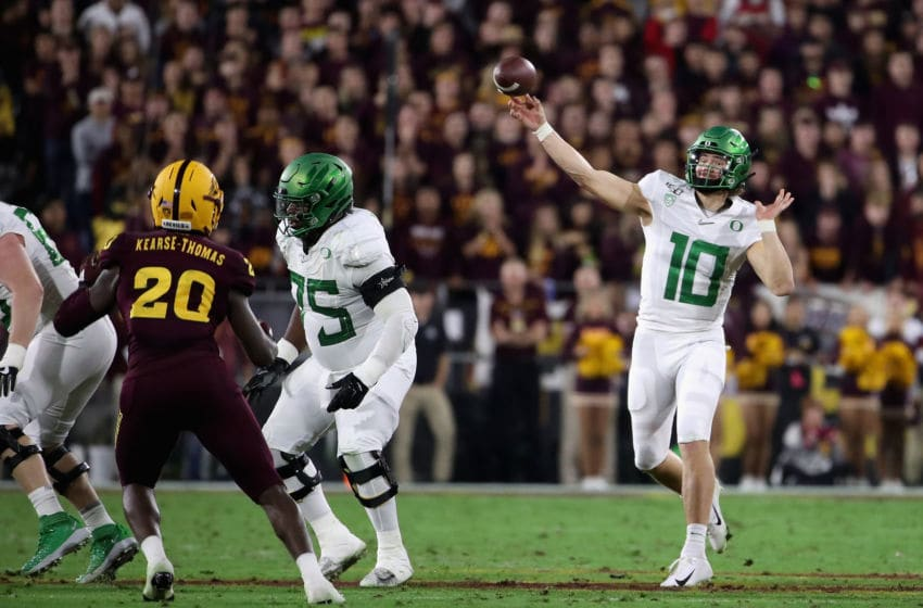 TEMPE, ARIZONA - NOVEMBER 23: Quarterback Justin Herbert #10 of the Oregon Ducks throws a pass during the second half of the NCAAF game against the Arizona State Sun Devils at Sun Devil Stadium on November 23, 2019 in Tempe, Arizona. The Sun Devils defeated the Ducks 31-28. (Photo by Christian Petersen/Getty Images)
