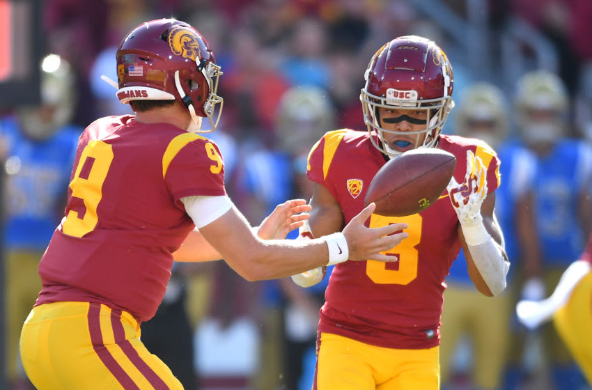 LOS ANGELES, CA - NOVEMBER 23: Quarterback Kedon Slovis #9 hands off the ball to wide receiver Amon-Ra St. Brown #8 of the USC Trojans in the first half of the game against the UCLA Bruins at the Los Angeles Memorial Coliseum on November 23, 2019 in Los Angeles, California. (Photo by Jayne Kamin-Oncea/Getty Images)