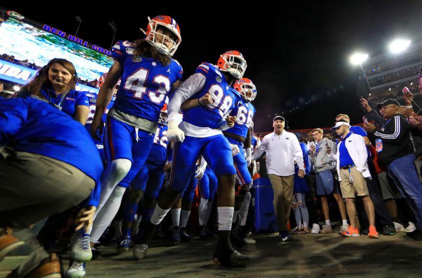 GAINESVILLE, FLORIDA - NOVEMBER 30: Head coach Dan Mullen and the Florida Gators take the field during a game against the Florida State Seminoles at Ben Hill Griffin Stadium on November 30, 2019 in Gainesville, Florida. (Photo by Mike Ehrmann/Getty Images)
