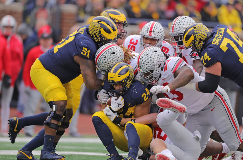 the Ohio State Buckeyes and the Michigan Wolverines (Photo by Leon Halip/Getty Images)