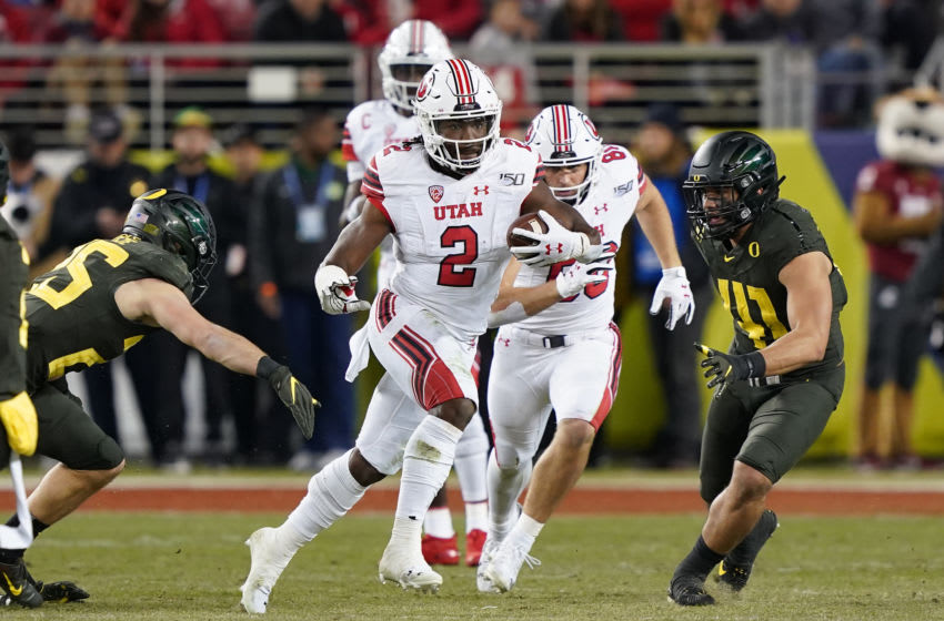 SANTA CLARA, CALIFORNIA - DECEMBER 06: Running back Zack Moss #2 of the Utah Utes carries the ball against the Oregon Ducks during the first half of the Pac-12 Championship Game at Levi's Stadium on December 06, 2019 in Santa Clara, California. (Photo by Thearon W. Henderson/Getty Images)