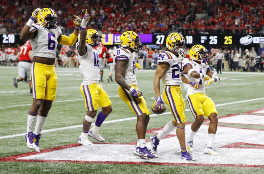 ATLANTA, GEORGIA - DECEMBER 07: Derek Stingley Jr. #24 of the LSU Tigers celebrates with teammates after intercepting a pass in the third quarter against the Georgia Bulldogs during the SEC Championship game at Mercedes-Benz Stadium on December 07, 2019 in Atlanta, Georgia. (Photo by Kevin C. Cox/Getty Images)