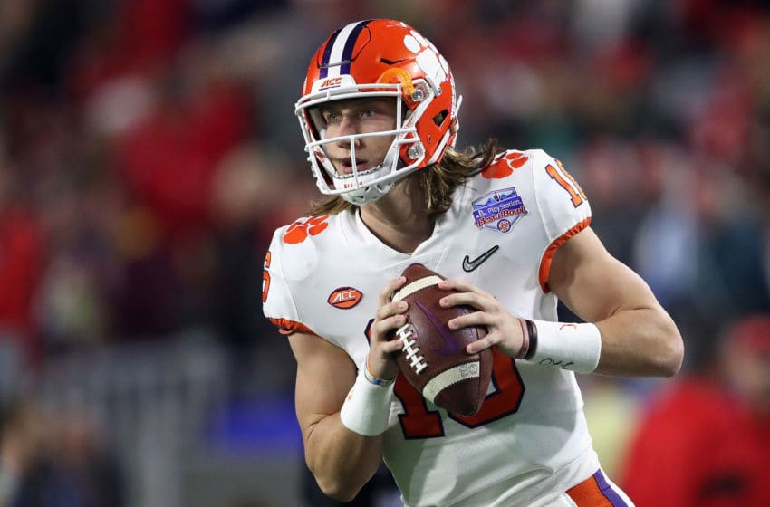 GLENDALE, ARIZONA - DECEMBER 28: Quarterback Trevor Lawrence #16 of the Clemson Tigers warms up before the PlayStation Fiesta Bowl against the Ohio State Buckeyes at State Farm Stadium on December 28, 2019 in Glendale, Arizona. The Tigers defeated the Buckeyes 29-23. (Photo by Christian Petersen/Getty Images)