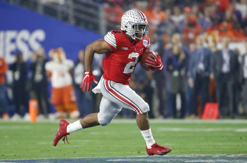 GLENDALE, ARIZONA - DECEMBER 28: Running back J.K. Dobbins #2 of the Ohio State Buckeyes carries the ball on a touchdown run against the Clemson Tigers during the first half of the College Football Playoff Semifinal at the PlayStation Fiesta Bowl at State Farm Stadium on December 28, 2019 in Glendale, Arizona. (Photo by Ralph Freso/Getty Images)