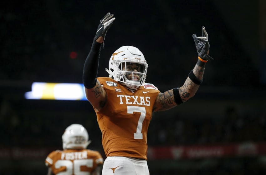 SAN ANTONIO, TX - DECEMBER 31: Caden Sterns #7 of the Texas Longhorns celebrates in the second half against the Utah Utes during the Valero Alamo Bowl at the Alamodome on December 31, 2019 in San Antonio, Texas. (Photo by Tim Warner/Getty Images)