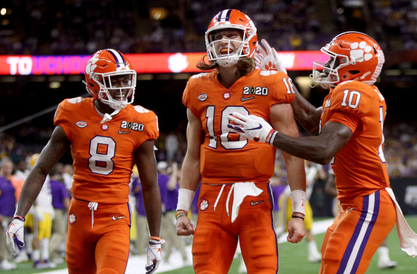 NEW ORLEANS, LOUISIANA - JANUARY 13: Trevor Lawrence #16 of the Clemson Tigers celebrates with teammates after scoring a touchdown against the LSU Tigers in the College Football Playoff National Championship game at Mercedes Benz Superdome on January 13, 2020 in New Orleans, Louisiana. (Photo by Chris Graythen/Getty Images)