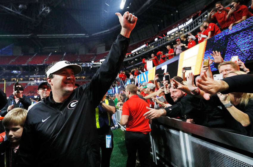 ATLANTA, GA - DECEMBER 02: Head coach Kirby Smart of the Georgia Bulldogs celebrates beating Auburn Tigers in the SEC Championship at Mercedes-Benz Stadium on December 2, 2017 in Atlanta, Georgia. (Photo by Jamie Squire/Getty Images)