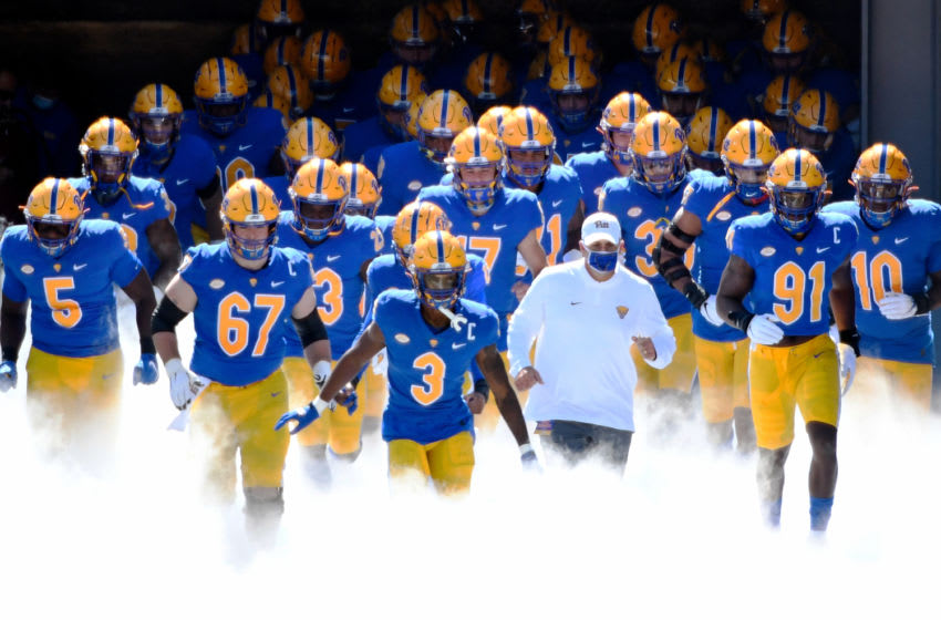 Members of Pitt football take the field (Photo by Justin Berl/Getty Images)