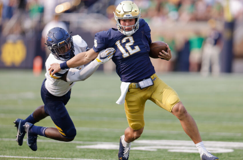SOUTH BEND, IN - SEPTEMBER 11: Tyler Buchner #12 of the Notre Dame Fighting Irish runs the ball during the game against the Toledo Rockets at Notre Dame Stadium on September 11, 2021 in South Bend, Indiana. (Photo by Michael Hickey/Getty Images)