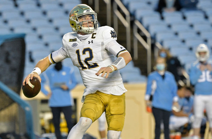 CHAPEL HILL, NORTH CAROLINA - NOVEMBER 27: Ian Book #12 of the Notre Dame Fighting Irish rolls out against the North Carolina Tar Heelsduring the first half of their game at Kenan Stadium on November 27, 2020 in Chapel Hill, North Carolina. (Photo by Grant Halverson/Getty Images)