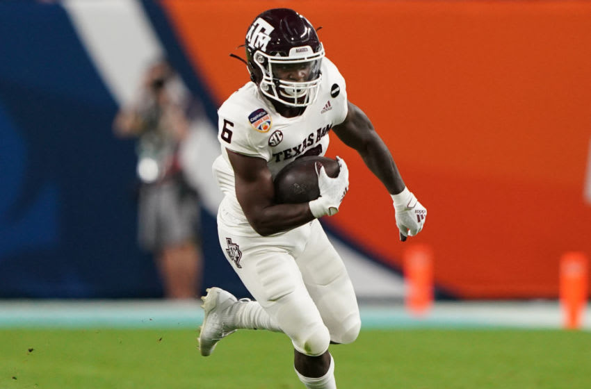 MIAMI GARDENS, FLORIDA - JANUARY 02: Devon Achane #6 of the Texas A&M Aggies runs with the ball against the North Carolina Tar Heels during the second half of the Capital One Orange Bowl at Hard Rock Stadium on January 02, 2021 in Miami Gardens, Florida. (Photo by Mark Brown/Getty Images)