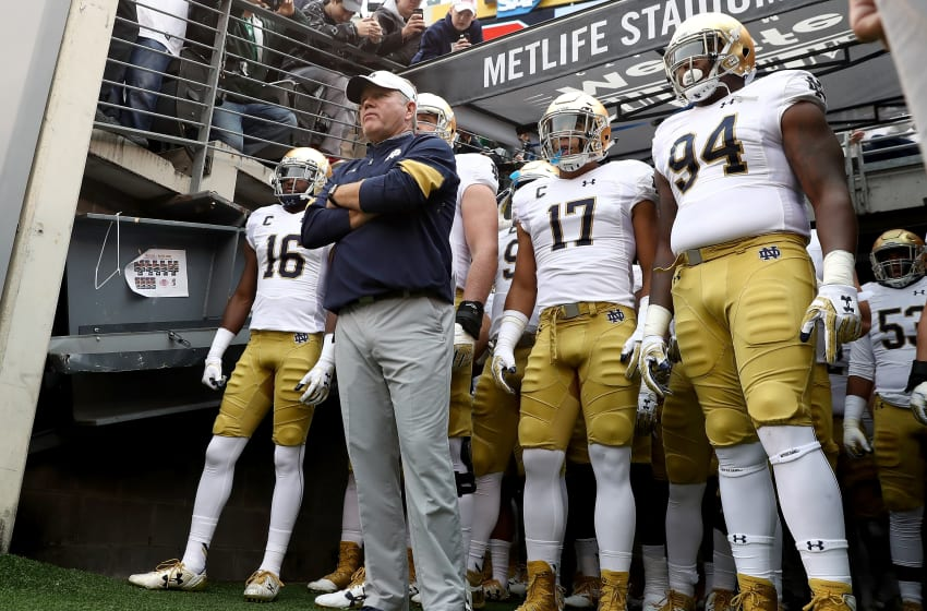 EAST RUTHERFORD, NJ - OCTOBER 01: Head coach Brian Kelly of the Notre Dame Fighting Irish and his team wait to head on to the field for the start of the game against the Syracuse Orange at MetLife Stadium on October 1, 2016 in East Rutherford, New Jersey. (Photo by Elsa/Getty Images)