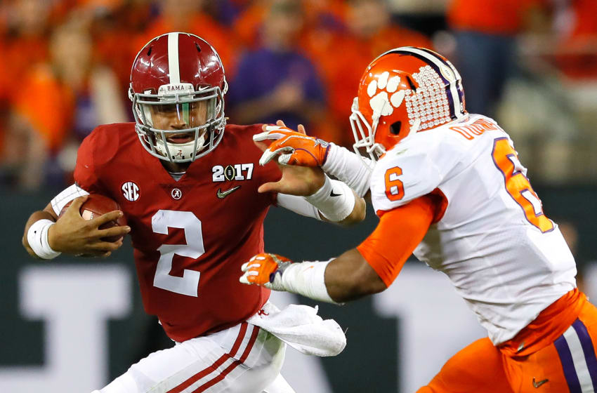 TAMPA, FL - JANUARY 09: Quarterback Jalen Hurts #2 of the Alabama Crimson Tide runs with the ball as linebacker Dorian O'Daniel #6 of the Clemson Tigers attempts to tackle him during the first half of the 2017 College Football Playoff National Championship Game at Raymond James Stadium on January 9, 2017 in Tampa, Florida. (Photo by Kevin C. Cox/Getty Images)