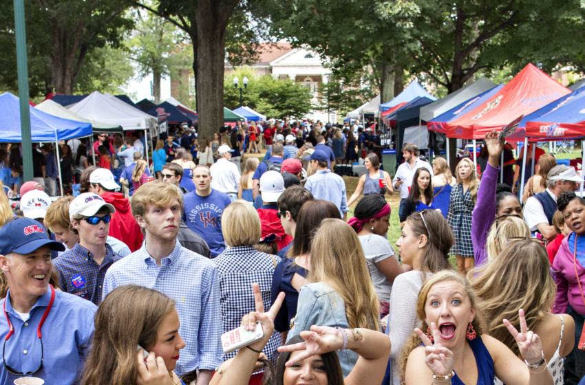 OXFORD, MS - SEPTEMBER 13: Fans of the Ole Miss Rebels enjoy the The Grove before a game against the Louisiana-Lafayette Ragin' Cajuns at Vaught-Hemingway Stadium on September 13, 2014 in Oxford, Mississippi. (Photo by Wesley Hitt/Getty Images)