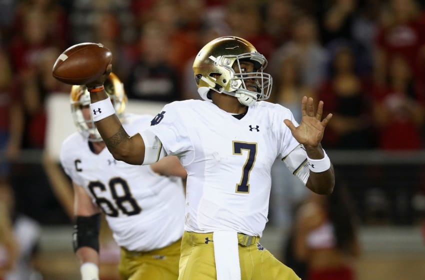 PALO ALTO, CA - NOVEMBER 25: Brandon Wimbush #7 of the Notre Dame Fighting Irish passes the ball against the Stanford Cardinal at Stanford Stadium on November 25, 2017 in Palo Alto, California. (Photo by Ezra Shaw/Getty Images)