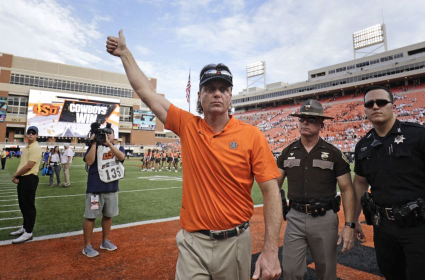 STILLWATER, OK - SEPTEMBER 15: Head Coach Mike Gundy of the Oklahoma State Cowboys leaves the field after the game against the Boise State Broncos at Boone Pickens Stadium on September 15, 2018 in Stillwater, Oklahoma. The Cowboys defeated the Broncos 44-21. (Photo by Brett Deering/Getty Images)