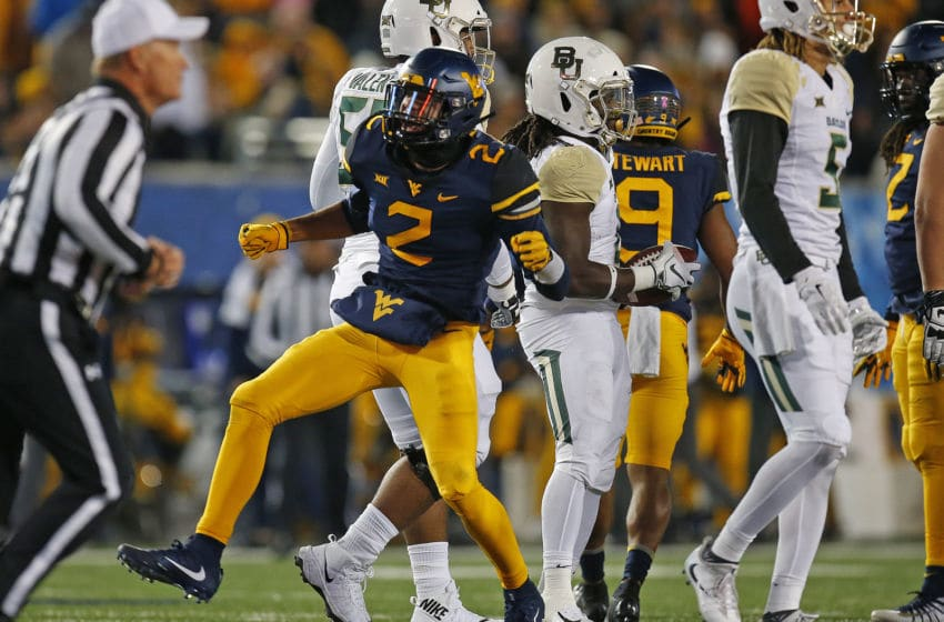 MORGANTOWN, WV - OCTOBER 25: Kenny Robinson Jr. #2 of the West Virginia Mountaineers celebrates after a tackle against the Baylor Bears at Mountaineer Field on October 25, 2018 in Morgantown, West Virginia. (Photo by Justin K. Aller/Getty Images)