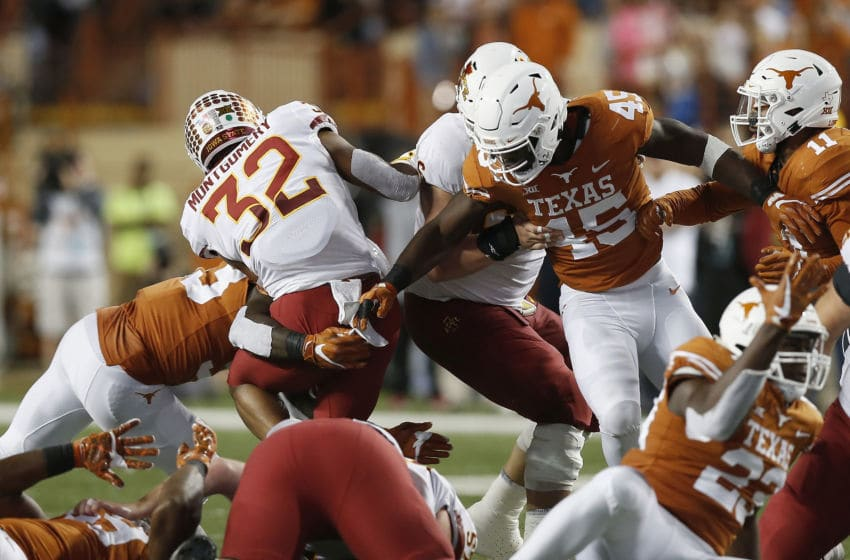 AUSTIN, TX - NOVEMBER 17: David Montgomery #32 of the Iowa State Cyclones is stopped at the line of scrimmage by Gary Johnson #33 of the Texas Longhorns and Anthony Wheeler #45 in the third quarter at Darrell K Royal-Texas Memorial Stadium on November 17, 2018 in Austin, Texas. (Photo by Tim Warner/Getty Images)