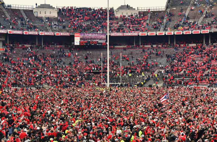 COLUMBUS, OH - NOVEMBER 24: Fans flood the field at Ohio Stadium after the Ohio State Buckeyes defeated the Michigan Wolverines 62-39 on November 24, 2018 in Columbus, Ohio. (Photo by Jamie Sabau/Getty Images)