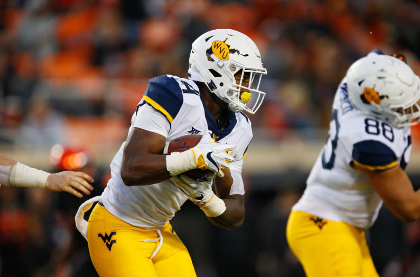 STILLWATER, OK - NOVEMBER 17: Running back Leddie Brown #4 of the West Virginia Mountaineers takes the ball against the the Oklahoma State Cowboys in the third quarter on November 17, 2018 at Boone Pickens Stadium in Stillwater, Oklahoma. Oklahoma State won 45-41. (Photo by Brian Bahr/Getty Images)