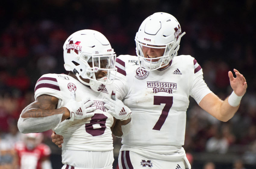 NEW ORLEANS, LA - AUGUST 31: Running back Kylin Hill #8 of the Mississippi State Bulldogs celebrates with quarterback Tommy Stevens #7 after scoring a touchdown during the third quarter of their game against the Louisiana-Lafayette Ragin Cajuns at Mercedes Benz Superdome on August 31, 2019 in New Orleans, Louisiana. (Photo by Michael Chang/Getty Images)