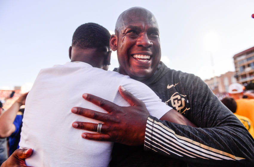 BOULDER, CO - SEPTEMBER 7: Head coach Mel Tucker of the Colorado Buffaloes hugs a fan who had rushed the field after the Colorado Buffaloes 34-31 overtime win over the Nebraska Cornhuskers at Folsom Field on September 7, 2019 in Boulder, Colorado. (Photo by Dustin Bradford/Getty Images)