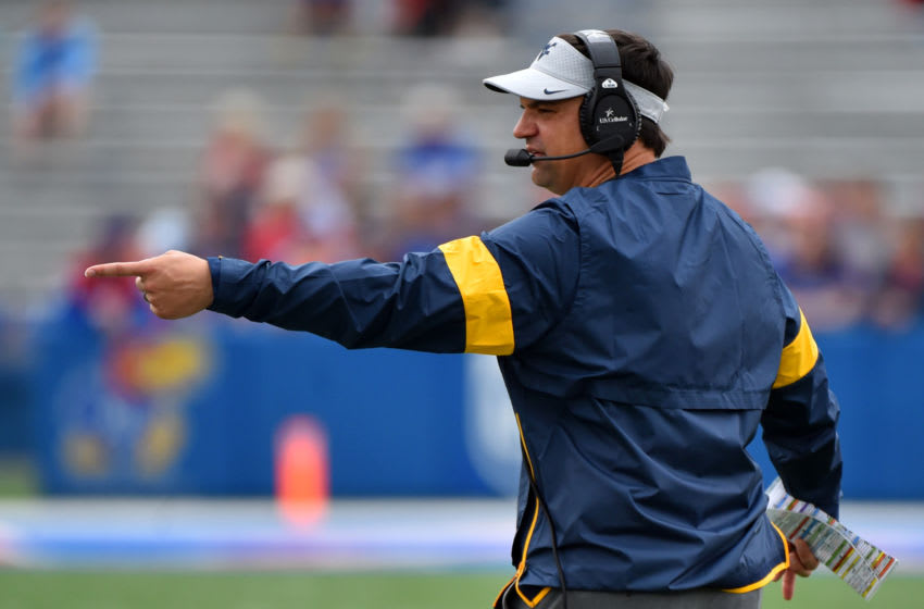 LAWRENCE, KANSAS - SEPTEMBER 21: Head coach Neal Brown of the West Virginia Mountaineers directs his team against the Kansas Jayhawks in the first quarter at Memorial Stadium on September 21, 2019 in Lawrence, Kansas. (Photo by Ed Zurga/Getty Images)