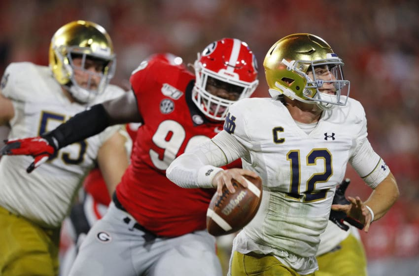 ATHENS, GEORGIA - SEPTEMBER 21: Ian Book #12 of the Notre Dame Fighting Irish looks to throw a second half pass in front of Tramel Walthour #90 of the Georgia Bulldogs at Sanford Stadium on September 21, 2019 in Athens, Georgia. (Photo by Kevin C. Cox/Getty Images)