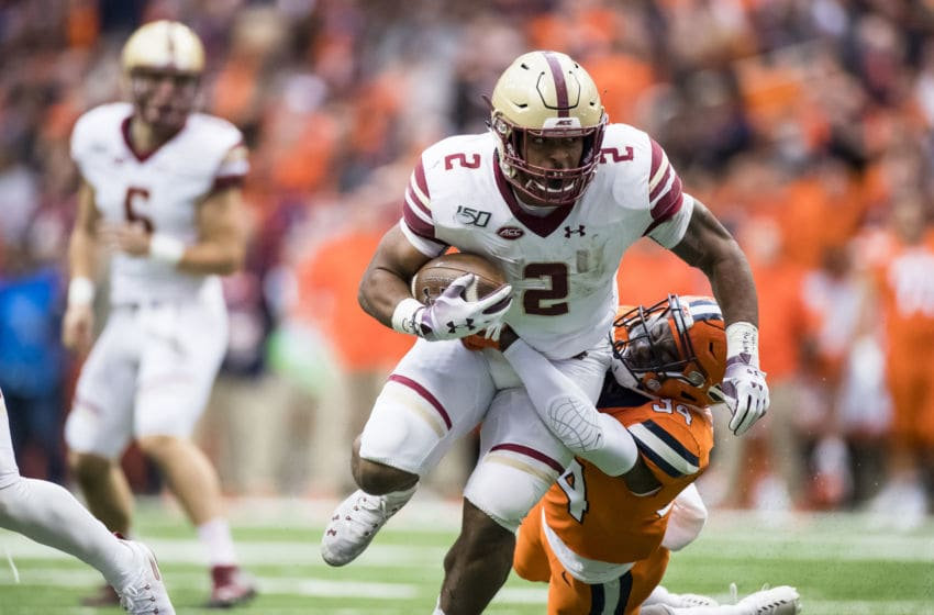 SYRACUSE, NY - NOVEMBER 02: AJ Dillon #2 of the Boston College Eagles drags Eric Coley #34 of the Syracuse Orange as Coley makes the tackle during the second quarter at the Carrier Dome on November 2, 2019 in Syracuse, New York. (Photo by Brett Carlsen/Getty Images)