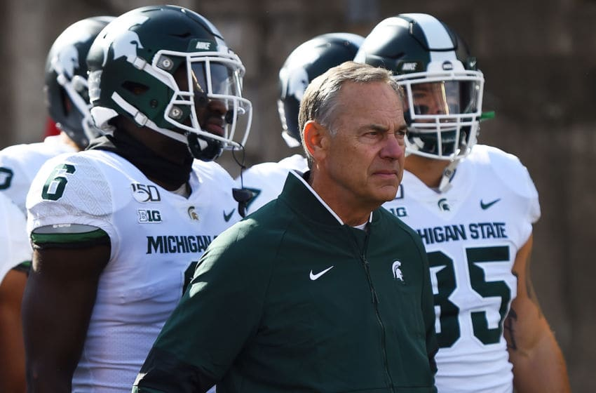 MADISON, WISCONSIN - OCTOBER 12: Head coach Mark Dantonio of the Michigan State Spartans takes the field with his team prior to a game against the Wisconsin Badgers at Camp Randall Stadium on October 12, 2019 in Madison, Wisconsin. (Photo by Stacy Revere/Getty Images)