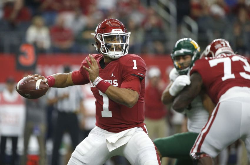 ARLINGTON, TX - DECEMBER 07: Jalen Hurts #1 of the Oklahoma Sooners looks to pass the ball against the Baylor Bears in the first quarter of the Big 12 Football Championship at AT&T Stadium on December 7, 2019 in Arlington, Texas. (Photo by Ron Jenkins/Getty Images)