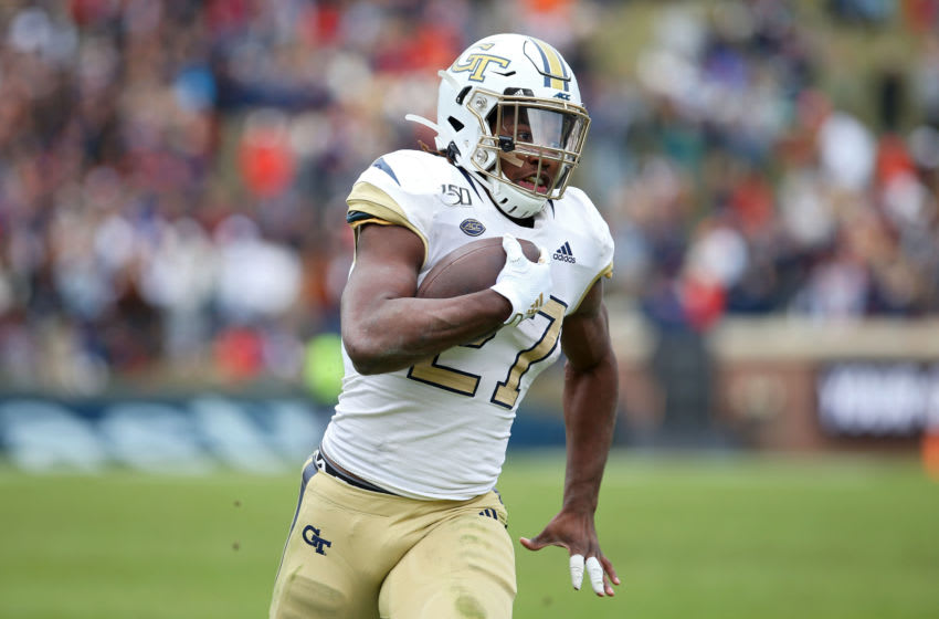 CHARLOTTESVILLE, VA - NOVEMBER 09: Jordan Mason #27 of the Georgia Tech Yellow Jackets rushes in the first half during a game against the Virginia Cavaliers at Scott Stadium on November 9, 2019 in Charlottesville, Virginia. (Photo by Ryan M. Kelly/Getty Images)