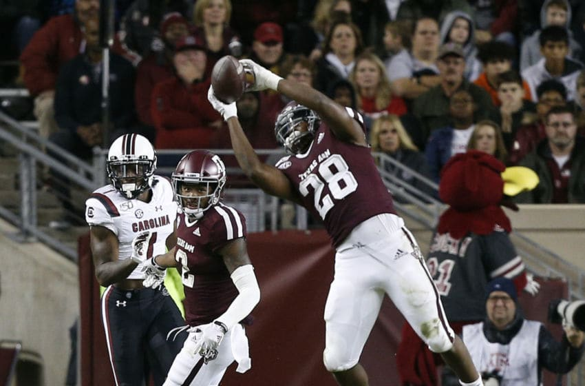 COLLEGE STATION, TEXAS - NOVEMBER 16: Isaiah Spiller #28 of the Texas A&M Aggies catches a pass in the flat against the South Carolina Gamecocks during the first half at Kyle Field on November 16, 2019 in College Station, Texas. (Photo by Bob Levey/Getty Images)