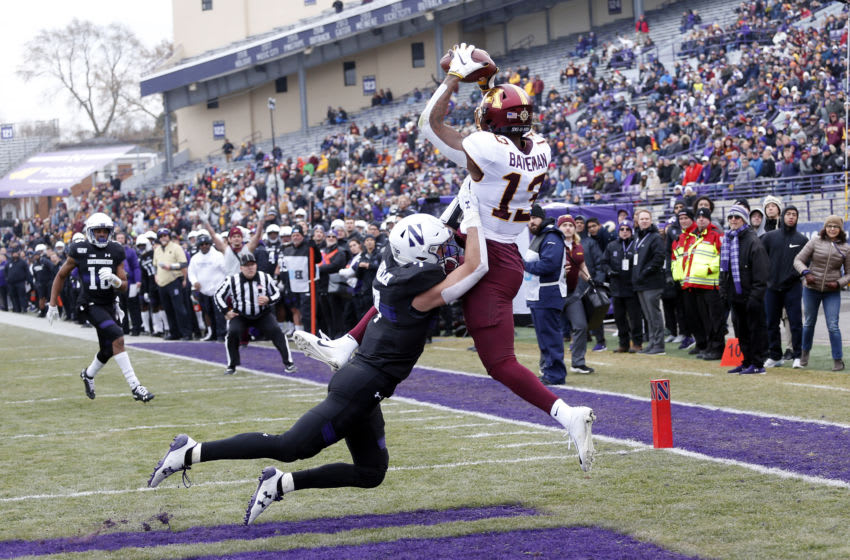 EVANSTON, ILLINOIS - NOVEMBER 23: Rashod Bateman #13 of the Minnesota Golden Gophers makes a catch for a touchdown in front of Travis Whillock #7 of the Northwestern Wildcats during the first quarter at Ryan Field on November 23, 2019 in Evanston, Illinois. (Photo by Nuccio DiNuzzo/Getty Images)
