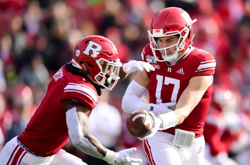 PISCATAWAY, NEW JERSEY - NOVEMBER 23: Johnny Langan #17 hands off the ball to Isaih Pacheco #1 of the Rutgers Scarlet Knights during the first half of their game against the Michigan State Spartans SHI Stadium on November 23, 2019 in Piscataway, New Jersey. (Photo by Emilee Chinn/Getty Images)