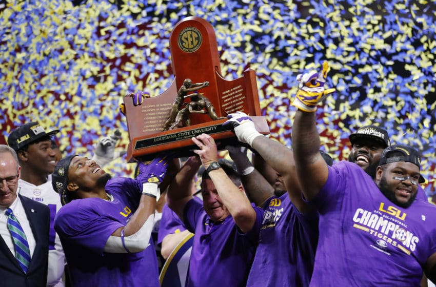ATLANTA, GEORGIA - DECEMBER 07: The LSU Tigers celebrate with the trophy after defeating the Georgia Bulldogs 37-10 to win the SEC Championship game at Mercedes-Benz Stadium on December 07, 2019 in Atlanta, Georgia. (Photo by Todd Kirkland/Getty Images)