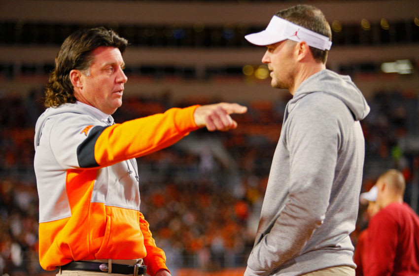 STILLWATER, OK - NOVEMBER 30: Head coach Mike Gundy of the Oklahoma State Cowboys points as he talks with head coach Lincoln Riley of the Oklahoma Sooners before their Bedlam game on November 30, 2019 at Boone Pickens Stadium in Stillwater, Oklahoma. OU won 34-16. (Photo by Brian Bahr/Getty Images)