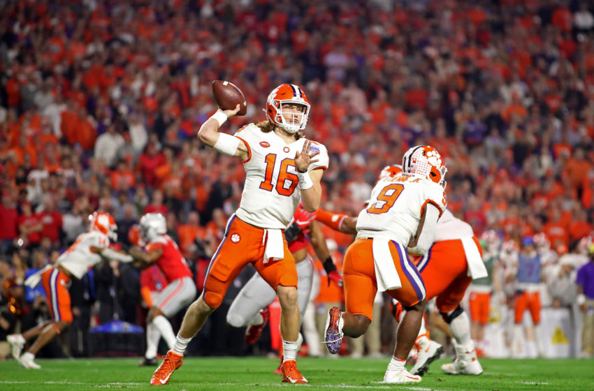 GLENDALE, ARIZONA - DECEMBER 28: Trevor Lawrence #16 of the Clemson Tigers looks to pass against the Ohio State Buckeyes in the second half during the College Football Playoff Semifinal at the PlayStation Fiesta Bowl at State Farm Stadium on December 28, 2019 in Glendale, Arizona. (Photo by Christian Petersen/Getty Images)