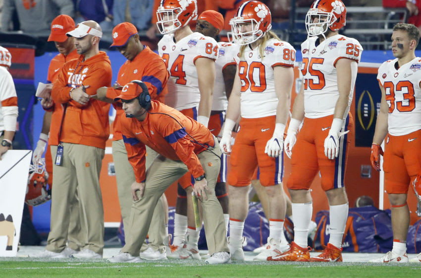 GLENDALE, ARIZONA - DECEMBER 28: Head coach Dabo Swinney of the Clemson Tigers watches from the sidelines during the first half of the College Football Playoff Semifinal against the Ohio State Buckeyes at the PlayStation Fiesta Bowl at State Farm Stadium on December 28, 2019 in Glendale, Arizona. (Photo by Ralph Freso/Getty Images)