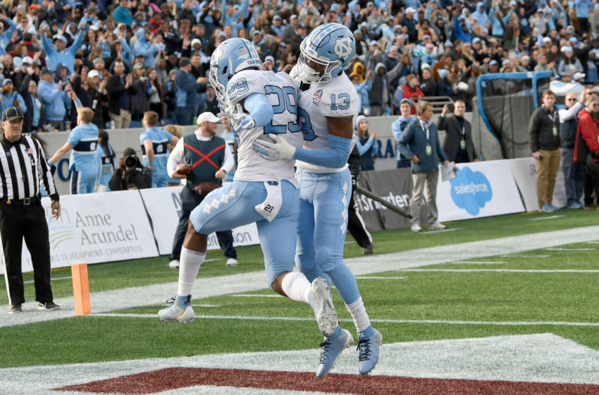ANNAPOLIS, MD - DECEMBER 27: Storm Duck #29 of the North Carolina Tar Heels celebrates with Don Chapman #13 after returning an interception for a touchdown against the Temple Owls in the Military Bowl Presented by Northrop Grumman at Navy-Marine Corps Memorial Stadium on December 27, 2019 in Annapolis, Maryland. (Photo by G Fiume/Getty Images)